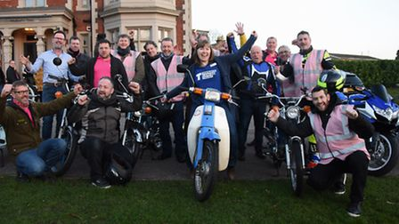 Jenny Townsend from the Teenage Cancer Trust with members of the Spooner Row Half Hundret Club who r