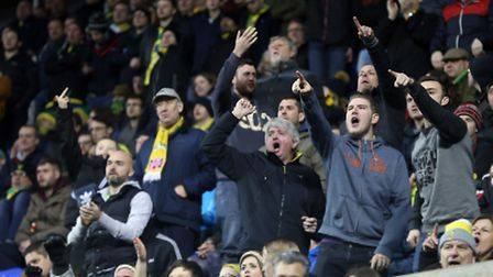 The traveling Norwich fans confusion turns to anger as Nelson Oliveira of Norwich is replaced by Cam