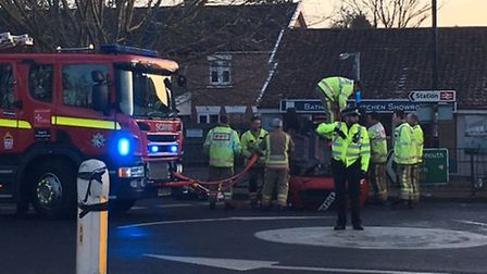 A woman had to be rescued from her car after it flipped over at a roundabout in Diss. Picture by Stu