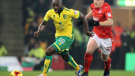 Huddersfield midfielder Aaron Mooy, pictured with Youssouf Mulumbu, was a dominant figure at Carrow