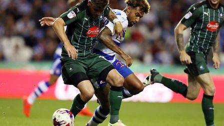 Danny Williams, centre, battles during Reading's EFL Cup tie with Plymotuh earlier this season. Pict