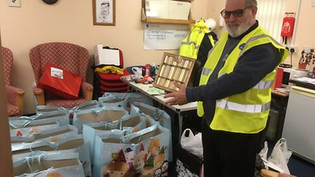 Great Yarmouth port chaplain Peter Paine with gift bags for the crew of the Malaviya Twenty. Picture