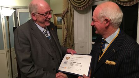 North Walsham Rotary President John Grier presents the certificate and badge to a delighted Denis Le