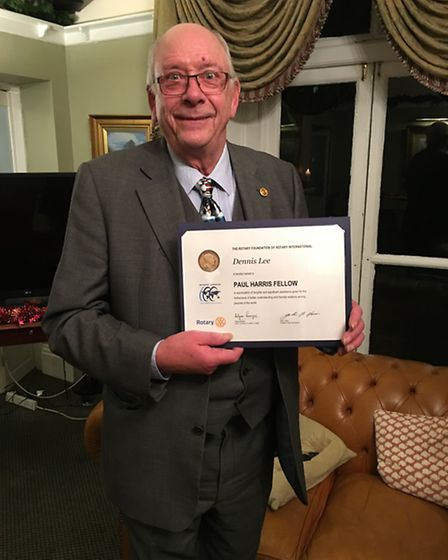 Rotarian Dennis Lee with his Paul Harris Fellow's certificate. Picture: PETER MAYNE