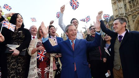 Ukip leader Nigel Farage greets his supporters on College Green in Westminster, London, after Britai