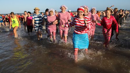 More than 200 thrill-seekers took part in the Boxing Day dip in Cromer, with many more turning out t