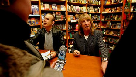 Francis Rossi and Rick Parfitt of Status Quo have their picture taken by a fan on a mobile phone, at