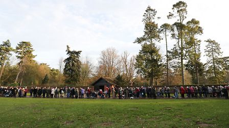 Members of the public wait to see the royal family arrive to attend the morning Christmas Day servic