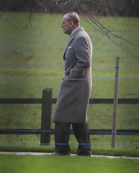 The Duke of Edinburgh leaves following the morning Christmas Day service at St Mary Magdalene Church