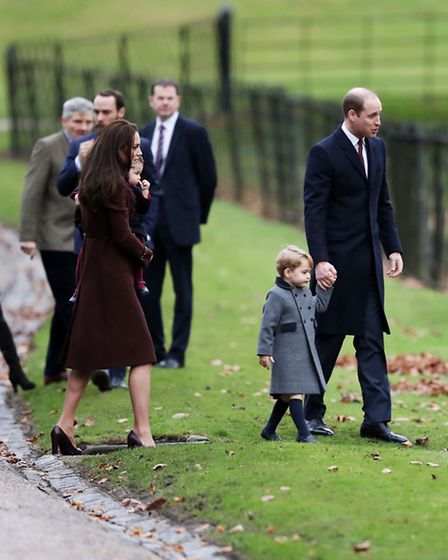 The Duke and Duchess of Cambridge, Prince George and Princess Charlotte arrive to attend the morning