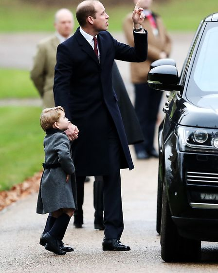 The Duke of Cambridge and Prince George arrive to attend the morning Christmas Day service at St Mar