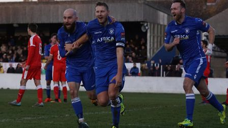 Rossi Jarvis, centre, celebrates after scoring Lowestoft's second goal at Crown Meadow. Photo: Shirl
