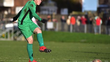 Connor Ingram scores the third goal from the penalty spot for Gorleston to seal victory over rivals