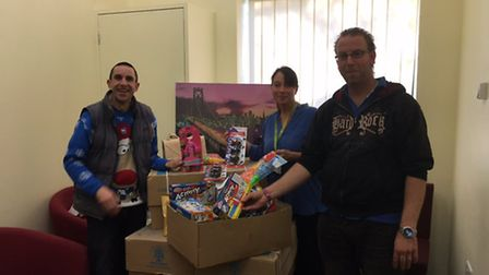 Jonathan Beck (right) donating toys he collected to Banardos along with colleague Mark Copland (left