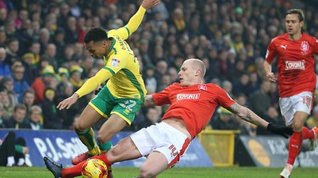 Jacob Murphy of Norwich and Aaron Mooy of Huddersfield Town in action during the Sky Bet Championshi