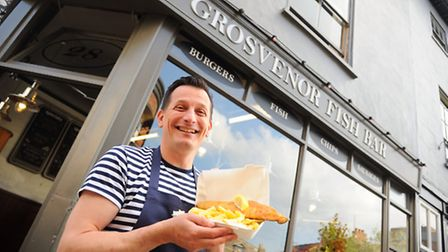 Christian Motta with fish and chips from his Grosvenor Fish Bar on Lower Goat Lane, Norwich. Picture