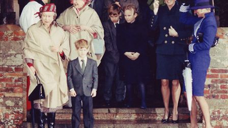 The Queen and memebers of the Royal Family prepared to brave the elements after morning service yest