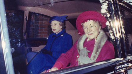 The Queen and the Queen Mother leaving by car to return to Sandringham House yesterday after the ser