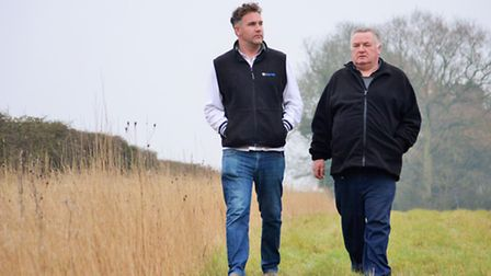 Charlie (left) and William Mack on land at Hempstead Hall which is on the proposed energy cable rout