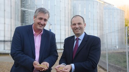 The four new silos at Crisp Malting, Great Ryburgh. Pictured are (L) Fengrain Ltd MD, Robert Munro a