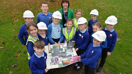 The children at St Mary's C of E Junior Academy in Long Stratton pose with their plans for their Sen