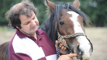 William Hand at the Rainbow Meadows Horse Sanctuary with Sarah the horse. Picture: Ian Burt