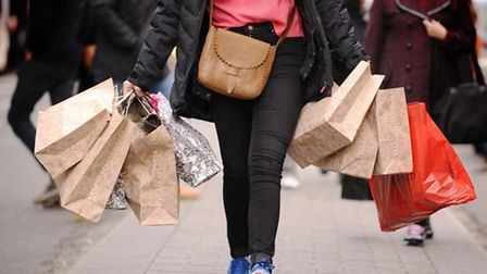 A shopper carrying shopping bags. Picture: Dominic Lipinski/PA Wire.