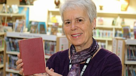 NWHS librarian Liz Sawyer with the overdue book from 1953 which has been returned. Picture: ANDY NEW