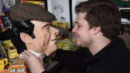 Oliver Allen, sales organiser at the Diss Auction Rooms, with a 'Del-Boy' mask from a collection of
