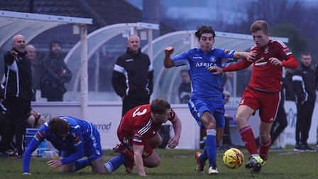 Lowestoft's Harry Barker challenges a Worthing player for the ball. Picture: Shirley D Whitlow