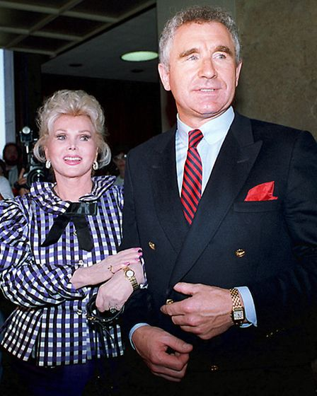 Actress Zsa Zsa Gabor and her husband, Frederic von Anhalt, leave court in Beverly Hills, Calif., in
