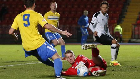 Dan Hanford (red top) of Gateshead FC stops a low cross during the first round FA Trophy match at Ga