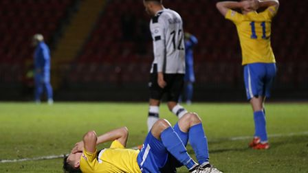Toby Hilliard of King's Lynn Town FC reacts to failing to connect to a cross during the first round