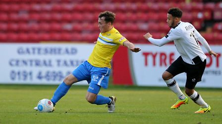 Wes Atkinson (r) of Gateshead FC and Toby Hilliard of King's Lynn Town FC during the first round FA