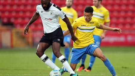 Jamal Fyfield (l) of Gateshead FC and Shaun McWilliams of King's Lynn Town FC during the first round