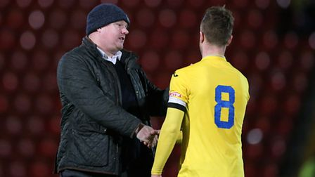 King's Lynn Town manager Gary Setchell (l) commiserates Lee Stevenson of King's Lynn Town FC after t