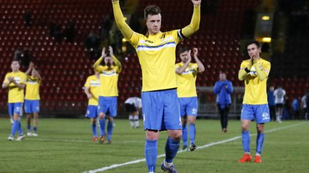 Lee Stevenson of King's Lynn Town FC thanks the travelling fans after the first round FA Trophy matc