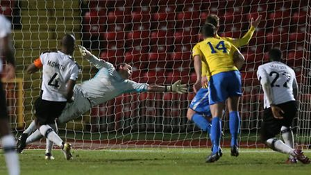Emanuel Smith (l) of Gateshead FC scoring to make it 2-0 during the first round FA Trophy match at G