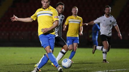 Toby Hilliard of King's Lynn Town FC fails to connect to a cross during the first round FA Trophy ma