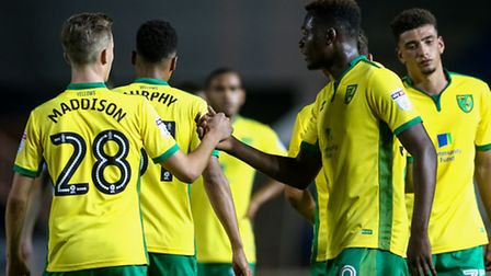 Norwich players celebrate another goal during the Checkatrade Trophy match at London Road, Peterboro