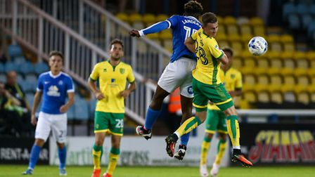 James Maddison of Norwich City U23 (right) competing in the air with Jermaine Anderson of Peterborou