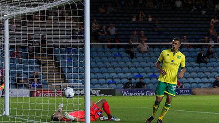 Carlton Morris of Norwich City U23 (right) makes sure the ball has crossed the line after a shot fro