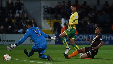 Josh Murphy of Norwich City U23 scores their second goal during the Checkatrade Trophy match at Unde