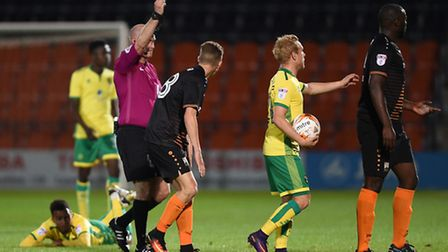 Bondz N'Gala of Barnet is sent off for a tackle on Norwich City U23's Josh Murphy during the Checka