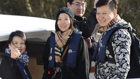 A delegate of 29 Chinese tourists being taken out on the Broads by Visit Britain during English Tour
