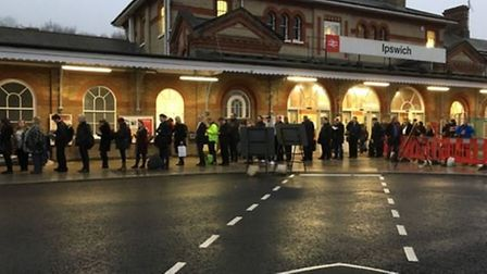 Travellers queue for a rail replacement bus at Ipswich train station on earlier this morning. Pictur