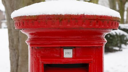 Post box covered in snow. Photo: PaulMaguire/Getty Images/iStockPhoto