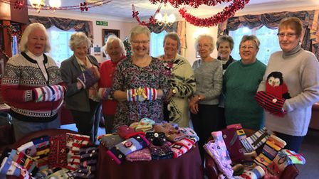 Members of Saham Toney Women's Institute group have knitted more than 50 sensory bands for the resid
