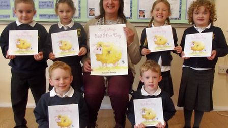 Author and illustrator Sandra Derry with her book Curly Sheep's Bad Hair Day at Kinsale Infant Schoo