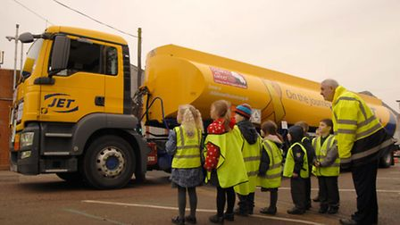 Mick Smith, of Suckling Transport, talks about road safety with Edgar Sewter Primary School pupils.